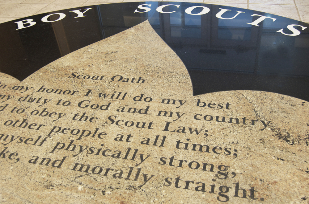 Boy Scout oath engraved on tile floor