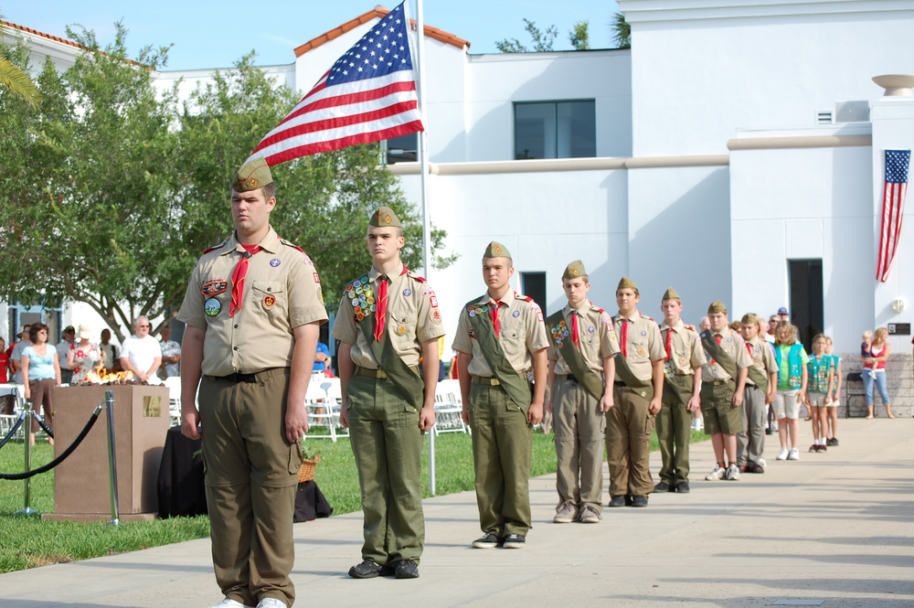 Boy Scouts standing at attention in Memorial Day ceremony